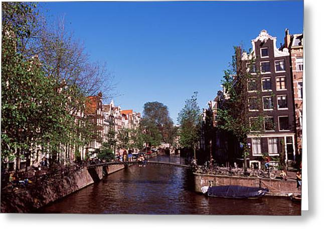 North Holland Greeting Cards - Buildings In A City, Amsterdam, North Greeting Card by Panoramic Images