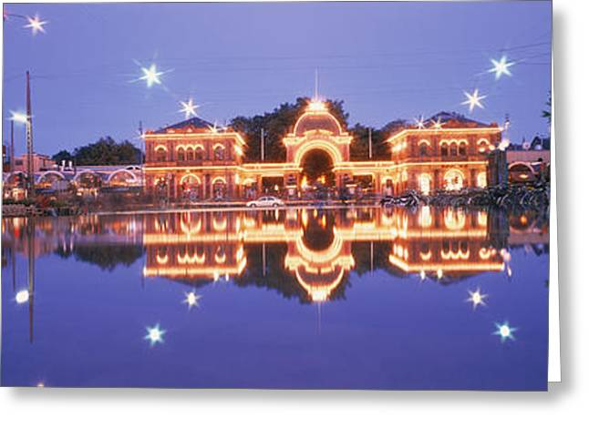 Amusements Greeting Cards - Buildings In An Amusement Park Lit Greeting Card by Panoramic Images