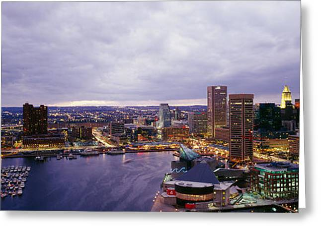 Locations Greeting Cards - Buildings Lit Up At Dusk, Baltimore Greeting Card by Panoramic Images