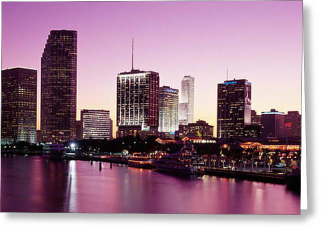 Biscayne Bay Greeting Cards - Buildings Lit Up At Dusk, Biscayne Bay Greeting Card by Panoramic Images