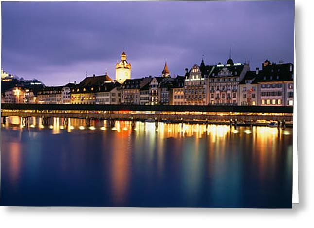 Reuss Greeting Cards - Buildings Lit Up At Dusk, Chapel Greeting Card by Panoramic Images