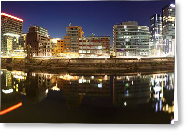 Buildings Lit Up At Dusk, Colorium Greeting Card by Panoramic Images