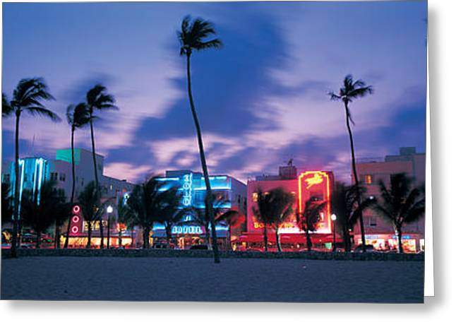 Urban Images Greeting Cards - Buildings Lit Up At Dusk, Miami Greeting Card by Panoramic Images