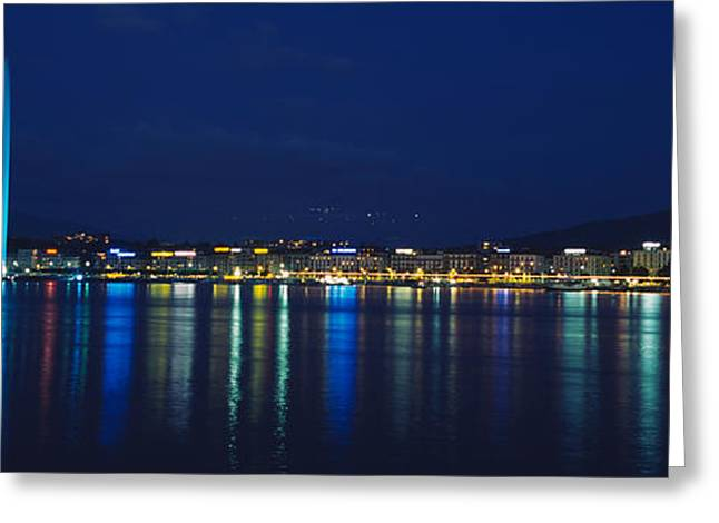 Lake Geneva Greeting Cards - Buildings Lit Up At Night, Jet Deau Greeting Card by Panoramic Images