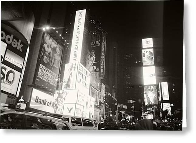 Commercial Photography Greeting Cards - Buildings Lit Up At Night, Times Greeting Card by Panoramic Images