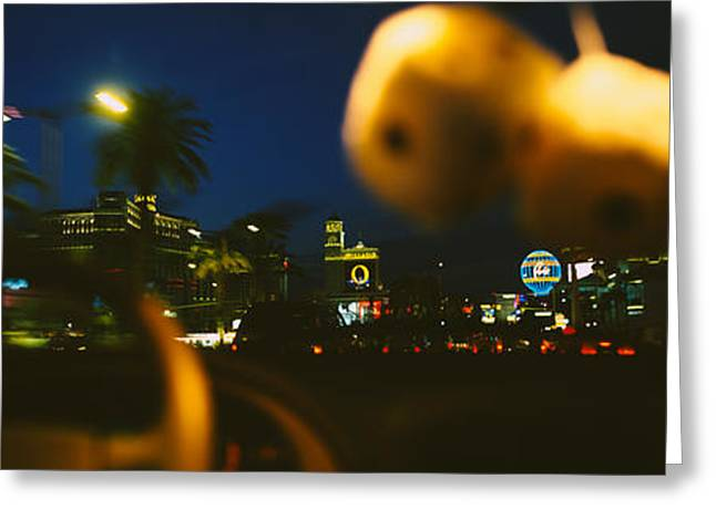 Steering Greeting Cards - Buildings Lit Up At Night Viewed Greeting Card by Panoramic Images