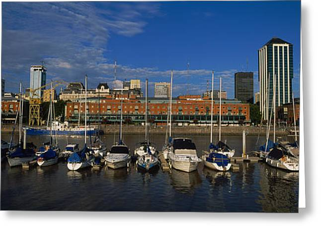 Reflections Of Sky In Water Greeting Cards - Buildings On The Waterfront, Puerto Greeting Card by Panoramic Images