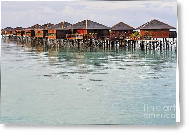Sami Sarkis Greeting Cards - Bungalow resort on lagoon Greeting Card by Sami Sarkis