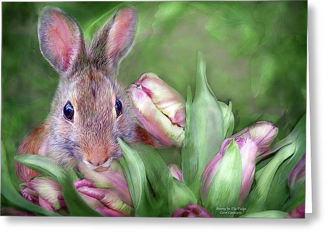Bunny In The Tulips Greeting Card by Carol Cavalaris