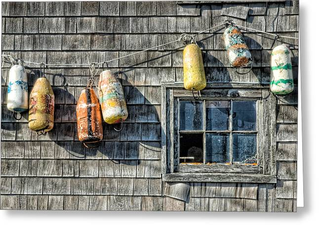 Glass Buoys Greeting Cards - Buoys on a Wall at Peggys Cove Greeting Card by Rob Huntley