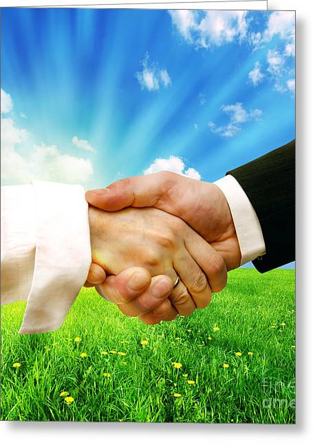 Cooperation Greeting Cards - Business handshake on nature background Greeting Card by Michal Bednarek