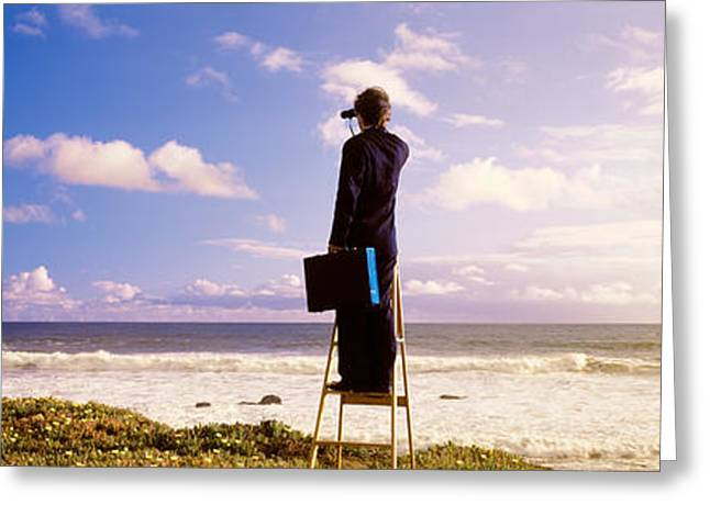 Businessman Standing On A Ladder And Greeting Card by Panoramic Images