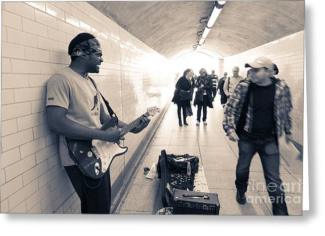 Playing Musical Instruments Greeting Cards - Busker playing electric guitar in underpass. Greeting Card by Peter Noyce