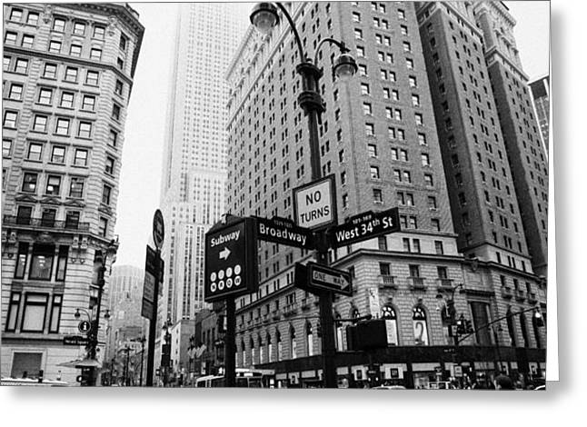 busy traffic junction of west 34th street st and broadway with empire state building shrouded mist Greeting Card by Joe Fox
