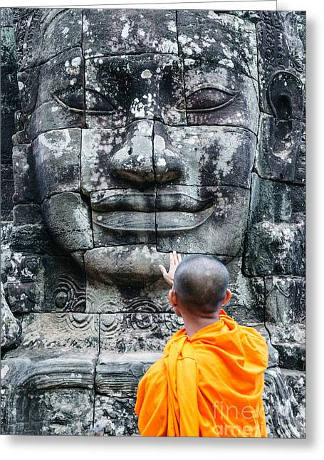Cambodia - Angkor Wat - Monk Touching Giant Buddha Statue Greeting Card by Matteo Colombo