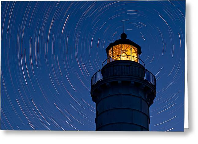 Stars Trail Greeting Cards - Cana Island Lighthouse Solstice Greeting Card by Steve Gadomski