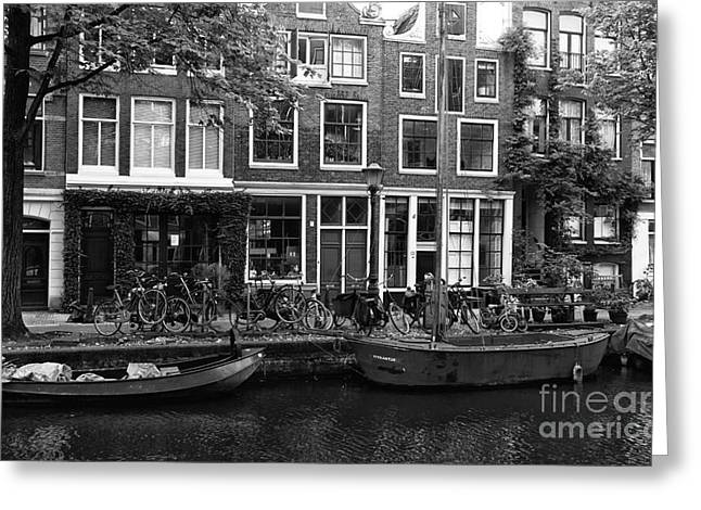 Boats In Water Greeting Cards - Canal Boats in Amsterdam mono Greeting Card by John Rizzuto