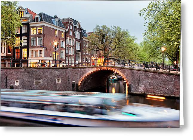 Old Home Place Greeting Cards - Canal Bridge and Boat Tour in Amsterdam at Evening Greeting Card by Artur Bogacki