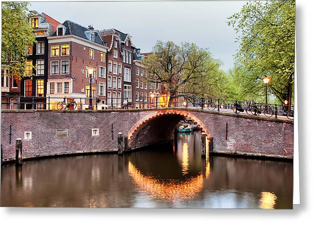 Old Home Place Greeting Cards - Canal Bridge in Amsterdam at Evening Greeting Card by Artur Bogacki