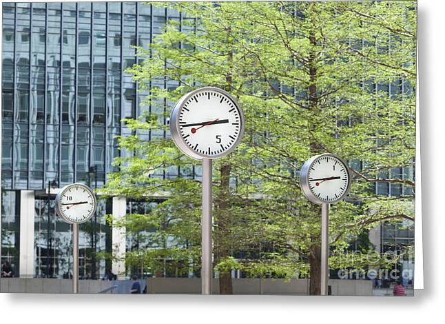 Synchronous Greeting Cards - Canary Wharf clocks in London Greeting Card by Roberto Morgenthaler