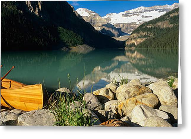 Canoe Photographs Greeting Cards - Canoe At The Lakeside, Lake Louise Greeting Card by Panoramic Images