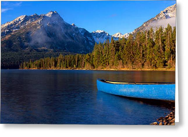 Reflections Of Sky In Water Greeting Cards - Canoe In Lake In Front Of Mountains Greeting Card by Panoramic Images