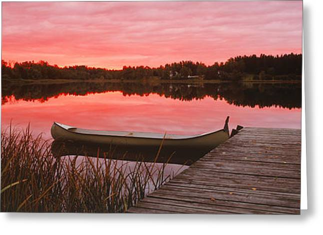 Canoe Photographs Greeting Cards - Canoe Tied To Dock On A Small Lake Greeting Card by Panoramic Images
