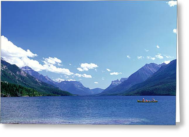 Canoeing Photographs Greeting Cards - Canoeing Waterton Lake Waterton Glacier Greeting Card by Panoramic Images