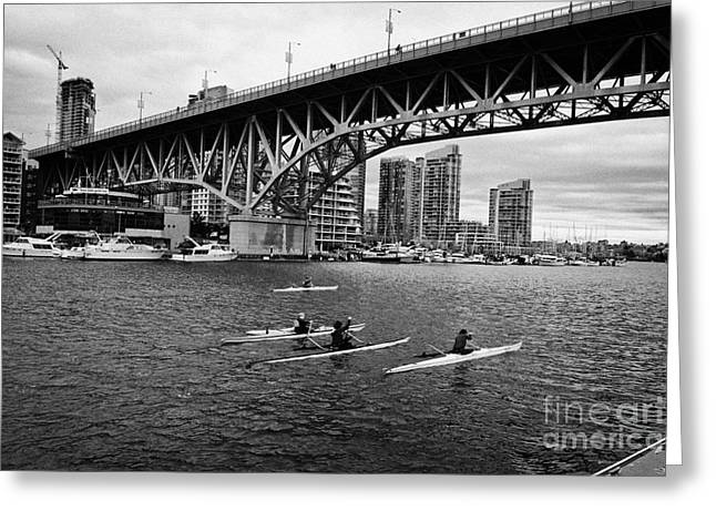 Canoe Photographs Greeting Cards - canoeists canoeing along false creek underneath the granville bridge Vancouver BC Canada Greeting Card by Joe Fox