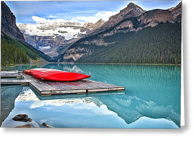 Chateau Greeting Cards - Canoes of Lake Louise Alberta Canada Greeting Card by George Oze
