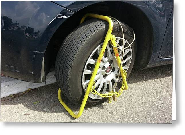 Car Clamped For Illegal Parking Greeting Card by Photostock-israel
