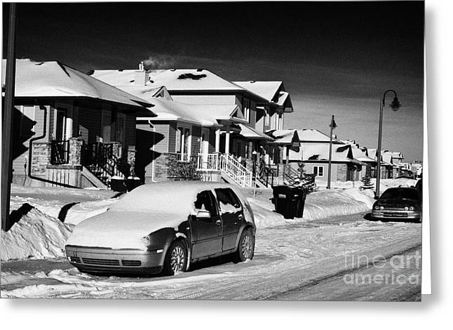 Wintry Greeting Cards - car covered in snow parked outside houses in the suburbs of Saskatoon Saskatchewan Canada Greeting Card by Joe Fox