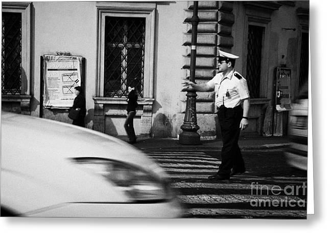 Police Officer Greeting Cards - car drives across crossing as Roman Municipal policeman directs traffic at a pedestrian crossing in the Via Teatro Marcello Rome Lazio Italy Greeting Card by Joe Fox