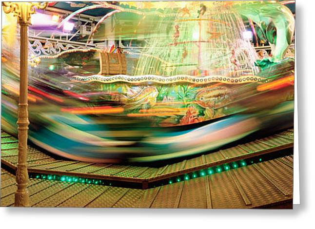 Amusement Park Ride Greeting Cards - Carousel In Motion, Amusement Park Greeting Card by Panoramic Images