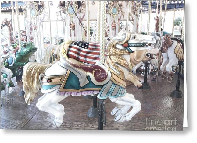 Festivals Fairs Carnival Photos Greeting Cards - Carousel Merry Go Round Horses - Dreamy Baby Blue Carousel Horses Carnival Ride and American Flag Greeting Card by Kathy Fornal