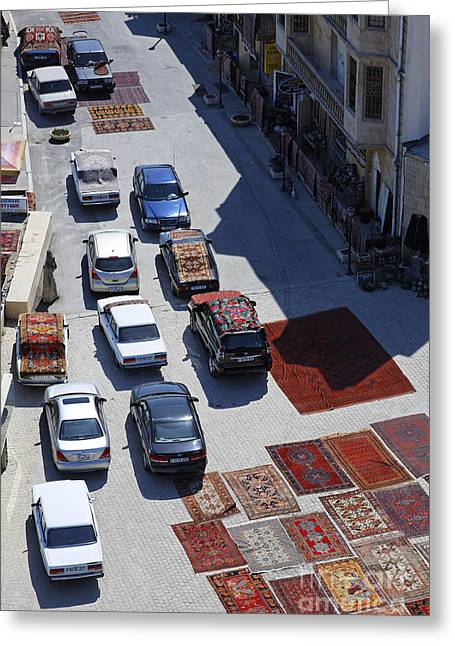 Maiden Greeting Cards - Carpets and cars on the road in Baku Old Town Azerbaijan Greeting Card by Robert Preston