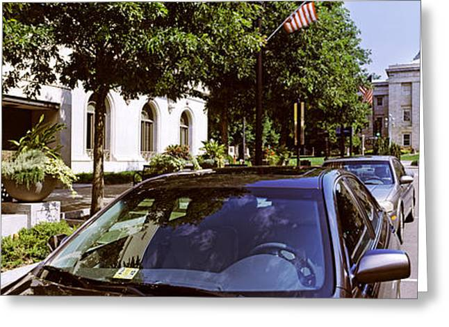 In-city Greeting Cards - Cars Parked In Front Of Transportation Greeting Card by Panoramic Images