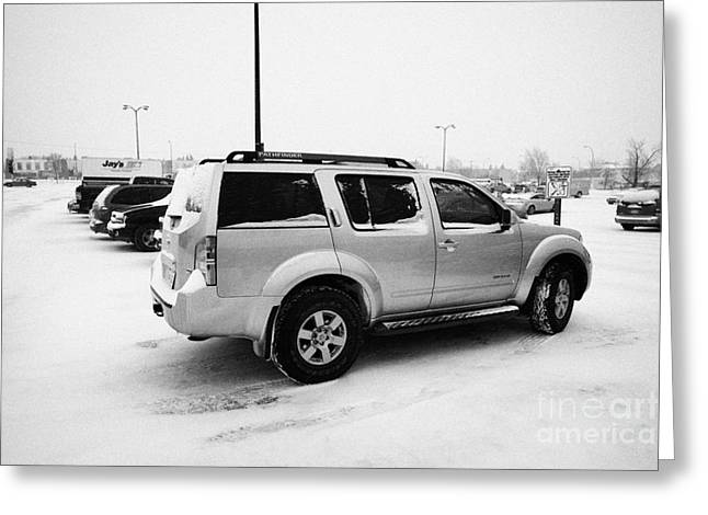 Car Park Greeting Cards - cars parked in store parking lot family reserved space in snowstorm blizzard Saskatoon Saskatchewan  Greeting Card by Joe Fox