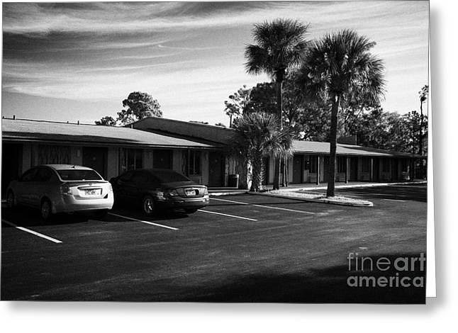 Downturn Greeting Cards - Cars Parked Outside Motel Rooms At Under Used Cheap Us Route 192 Motel In Kissimmee Florida Usa Greeting Card by Joe Fox