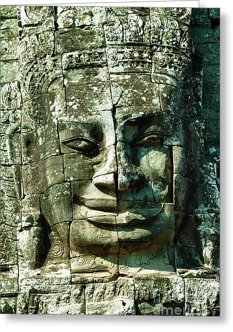Wat Angkor Greeting Cards - Carved face at Bayon Temple Angkor Cambodia Greeting Card by Fototrav Print