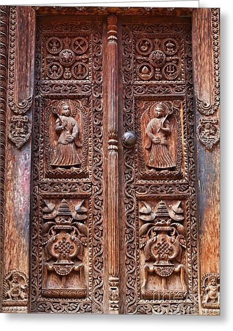Religious Art Photographs Greeting Cards - Carved wooden door at Bhaktapur in Nepal Greeting Card by Robert Preston