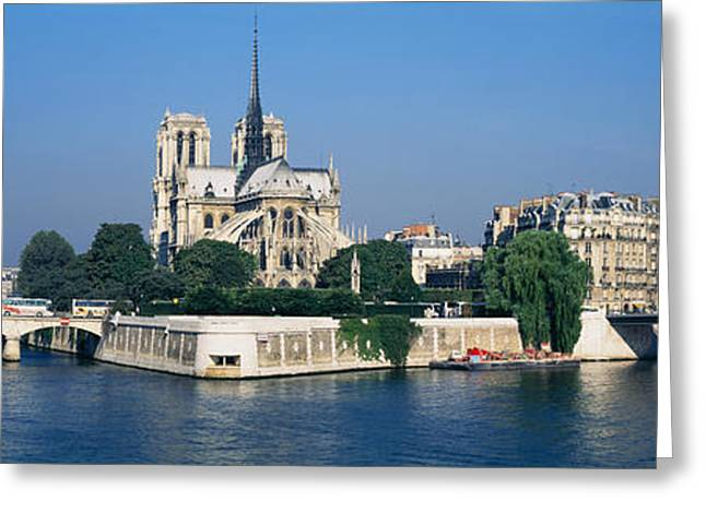 Sidewalks. Arches Greeting Cards - Cathedral Along A River, Notre Dame Greeting Card by Panoramic Images