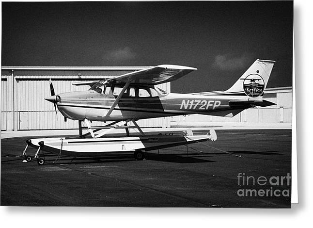 Single-engine Photographs Greeting Cards - cessna 172L fixed wing single engine seaplane key west international airport florida keys usa Greeting Card by Joe Fox