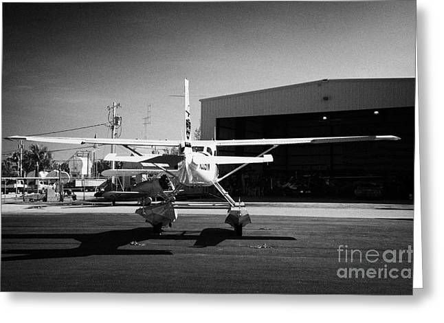 Cessna Greeting Cards - Cessna U206g Fixed Wing Single Engine Seaplane In Front Of Hangar Key West International Airport Flo Greeting Card by Joe Fox