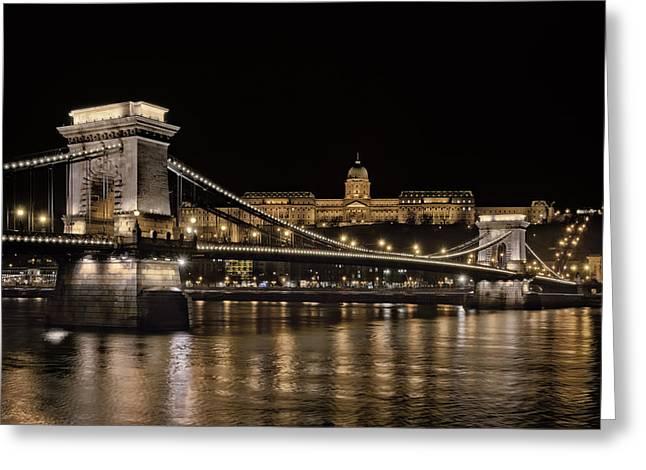 Chain Bridge Greeting Cards - Chain Bridge and Buda Castle Winter Night Greeting Card by Joan Carroll