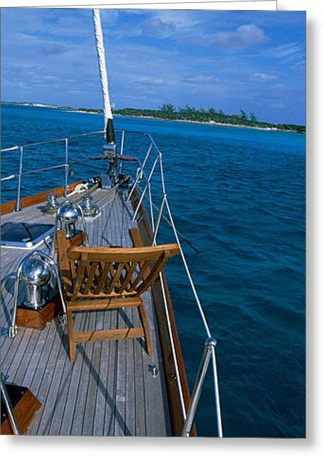 Sailboat Images Greeting Cards - Chair On A Boat Deck, Exumas, Bahamas Greeting Card by Panoramic Images