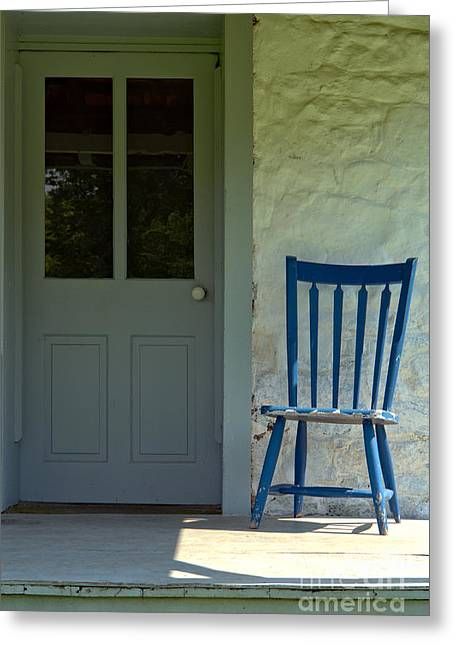 Front Porches Greeting Cards - Chair on Farmhouse Porch Greeting Card by Olivier Le Queinec