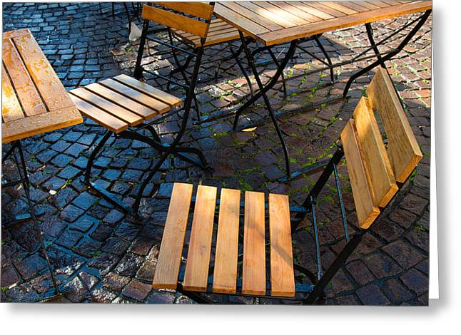 Empty Chairs Greeting Cards - Chairs and tables - sunlight after the rain Greeting Card by Matthias Hauser
