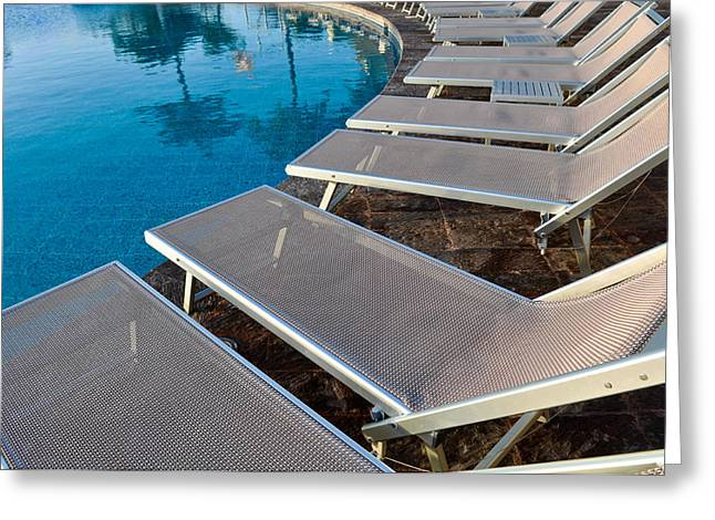 Chaise-lounge Greeting Cards - Chairs around Hotel Pool Greeting Card by Brandon Bourdages