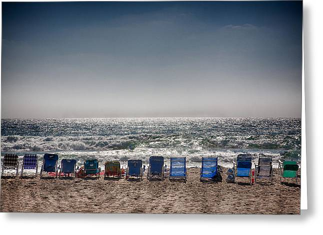 Chairs watching the sunset Greeting Card by Peter Tellone